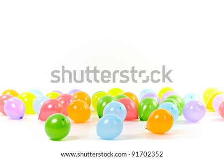 Group of colored balloons on white background - stock photo