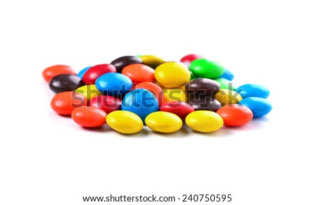 Group of colored candy on a white background - stock photo