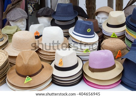 Group of colored hats for sale, at the Market.