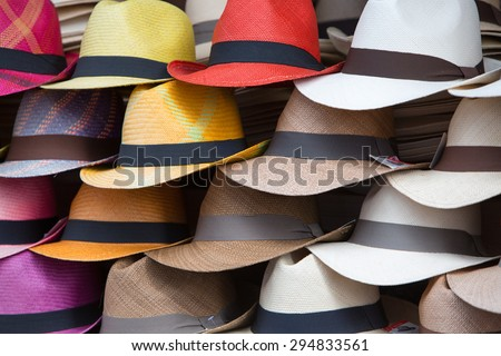 Group of colored hats for sale, hanging on a wall, Otavalo Market. Ecuador - stock photo