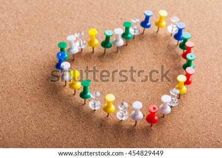 Group of Colored Pins arranged as Heart Shape - stock photo