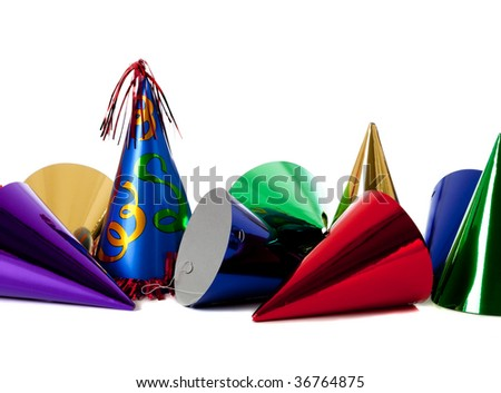 Group of colorful birthday party hats on white background with copy space - stock photo