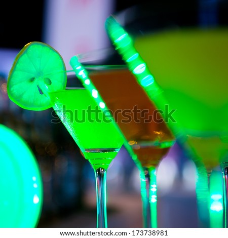 Group of colorful cocktail in martini glasses.