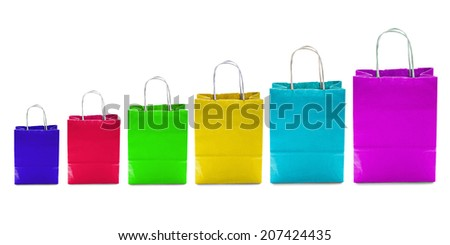Group of colorful craft paper handbags on white background - stock photo
