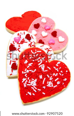 Group of colorful heart-shaped Valentines Day cookies with icing over white - stock photo