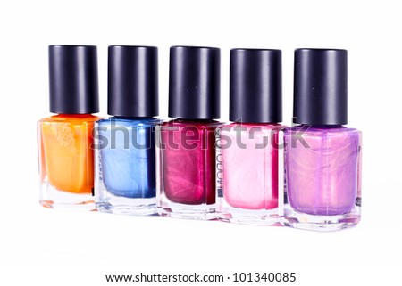 Group of colorful nail polishes isolated on white