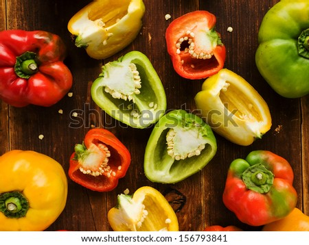 Group of colorful peppers on the wooden background. Viewed from above. - stock photo