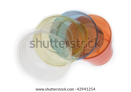 Group of colorful plastic glasses isolated over white background