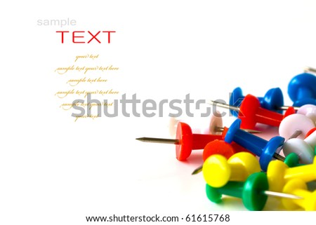 Group of colorful push pins on white background. - stock photo