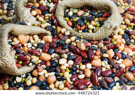 Group of colorful various beans or lentils and whole grains seeds or cereal background. mung bean, peanut or groundnut, blackbean, red kidney bean, soybean, pinto beans, Millet. - stock photo