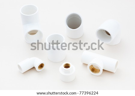 Group of combined fittings for PVC pipes in studio - stock photo