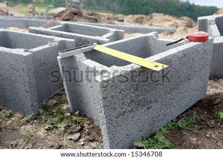 Group of concrete shuttering blocks and metal protractor