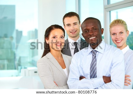 Group of confident business partners looking at camera