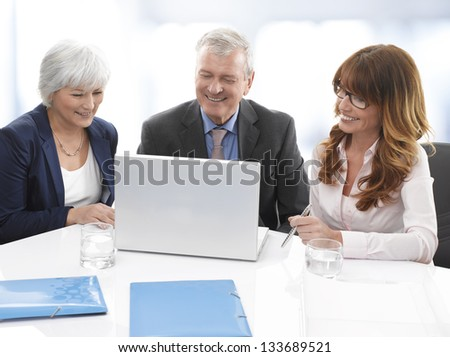 Group of confident professional managers  in the office - stock photo