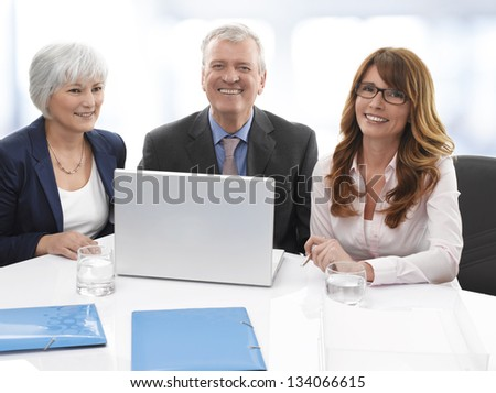 Group of confident professional managers working in the office. Shallow focus. - stock photo