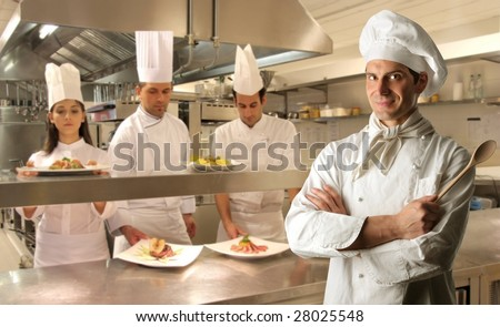 group of cooks in a kitchen - stock photo