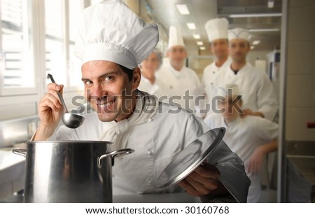 group of cooks in a restaurant kitchen - stock photo