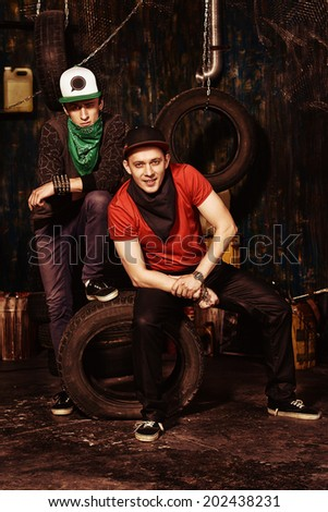 Group of cool guys hang out in the garage. Hip-hop style.  - stock photo