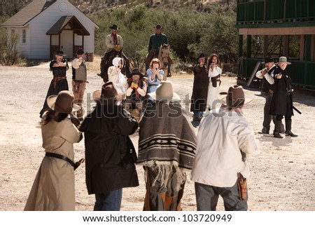 Group of cowboys and gunfighters in an old west shoot out - stock photo