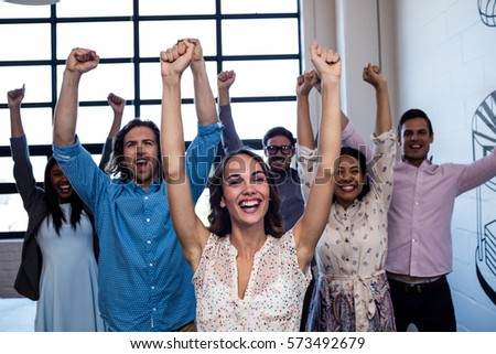 Group of coworkers hands up in the office