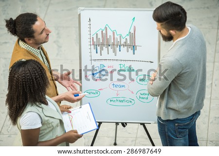 Group of creative young people discuss important project together. - stock photo