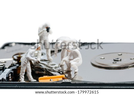 Group of criminologists inspecting broken hard rive. Technology concept - stock photo