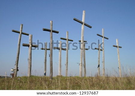 Group of crosses on a hill of blue sky