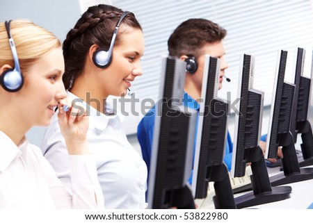 Group of customer representatives working in the computer class - stock photo