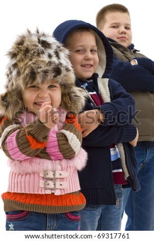 Group of 3 cute children posing together, smiling. Isolated on white background, focus on girls in the foregroud.? - stock photo