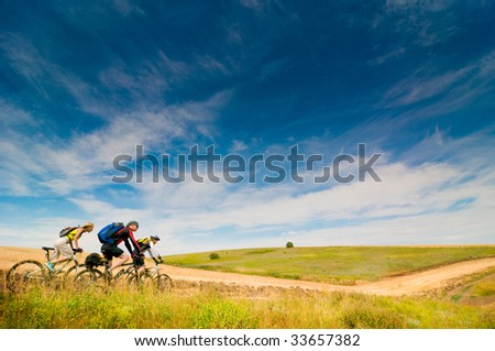group of cyclists relax biking outdoors - stock photo
