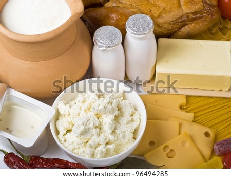 Group of dairy milk products ingredients on wood board