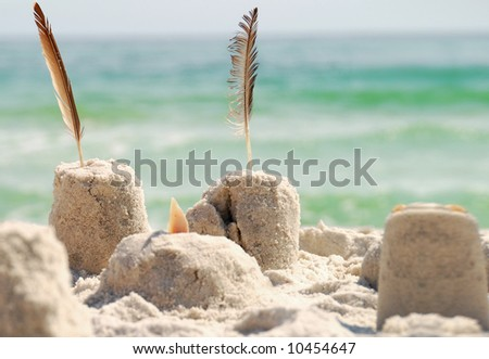 Group of decorated sand castles on beach - stock photo