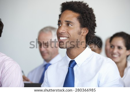 Group Of Delegates Listening To Presentation At Conference - stock photo