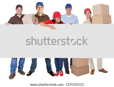 Group of delivery people presenting banner. Isolated on white