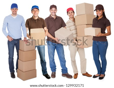 Group of delivery people with boxes. Isolated on white - stock photo
