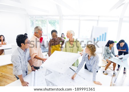 Group of Designers Planning and Discussing About a New Project - stock photo