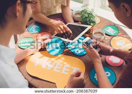 Group of designers working on icons for the application - stock photo