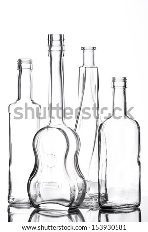 Group of different bottles with nice design on white. - stock photo