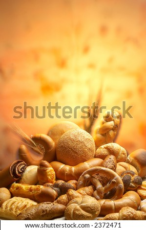 Group of different bread products photographed with light brush - stock photo
