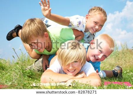 Group of different children having good summertime - stock photo