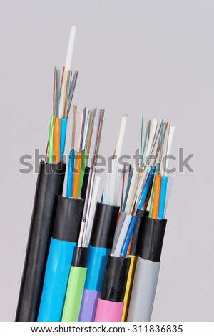 Group of 7 different fiber optic cable  ends with stripped jacket layers and exposed colored fibers, angled view, Melbourne 2015 - stock photo