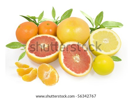 group of different fresh citrus fruits with green leaves isolated on white with clipping path