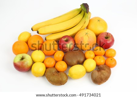 group of different fruits on white background