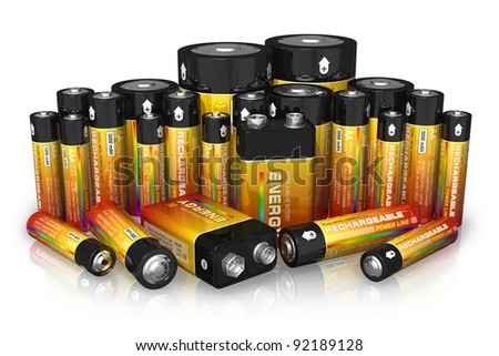Group of different size batteries isolated on white reflective background - stock photo