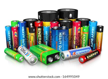 Group of different size color batteries isolated on white background with reflection effect - stock photo