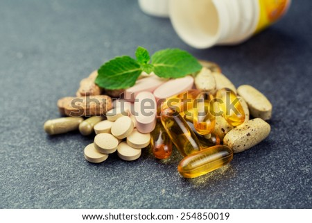 Group of different vitamins and pills - stock photo