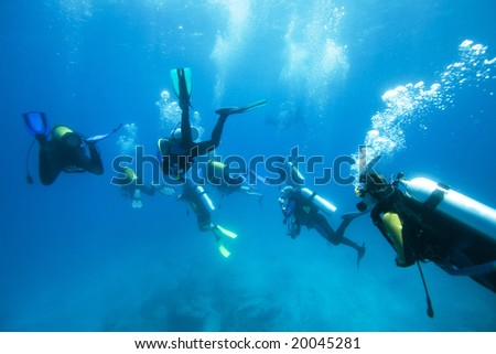 Group of divers in the Indian Ocean - stock photo