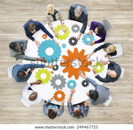 Group of Diverse Business People in a Meeting with Gears - stock photo