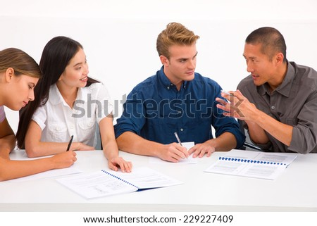 Group of diverse business people in meeting - stock photo