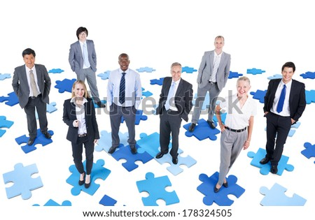 Group of Diverse Business People Standing on Jigsaw Puzzle - stock photo